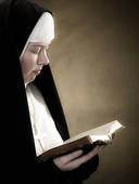 nun reading Bible